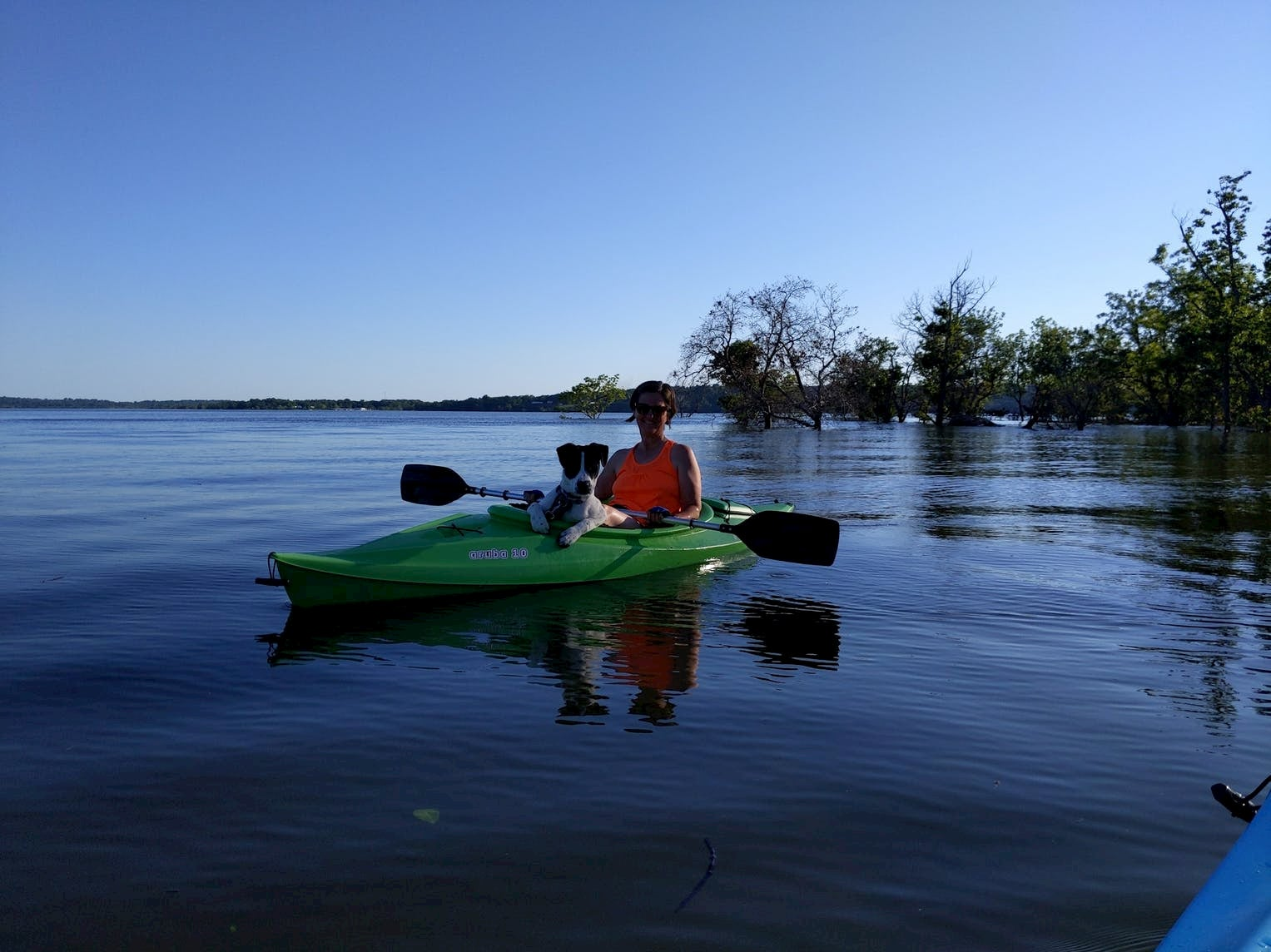 Women paddling in kayak with a dog at Sequoyah State Park.