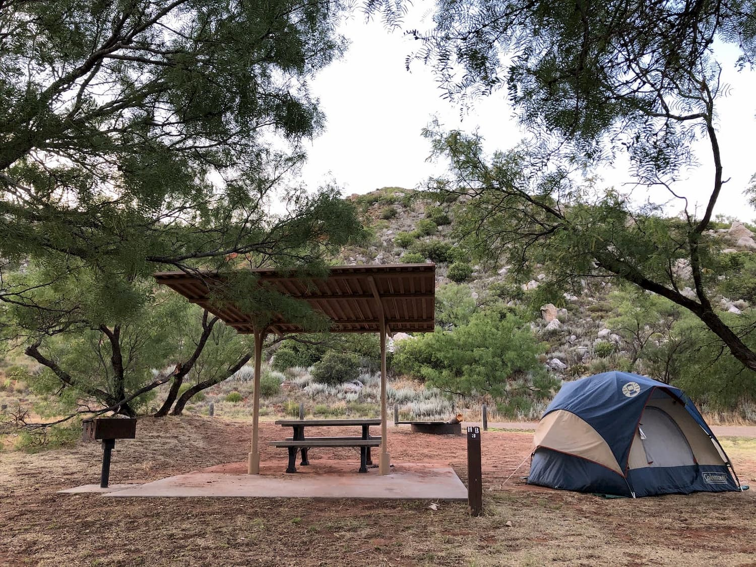 tent and picnic table at campsite