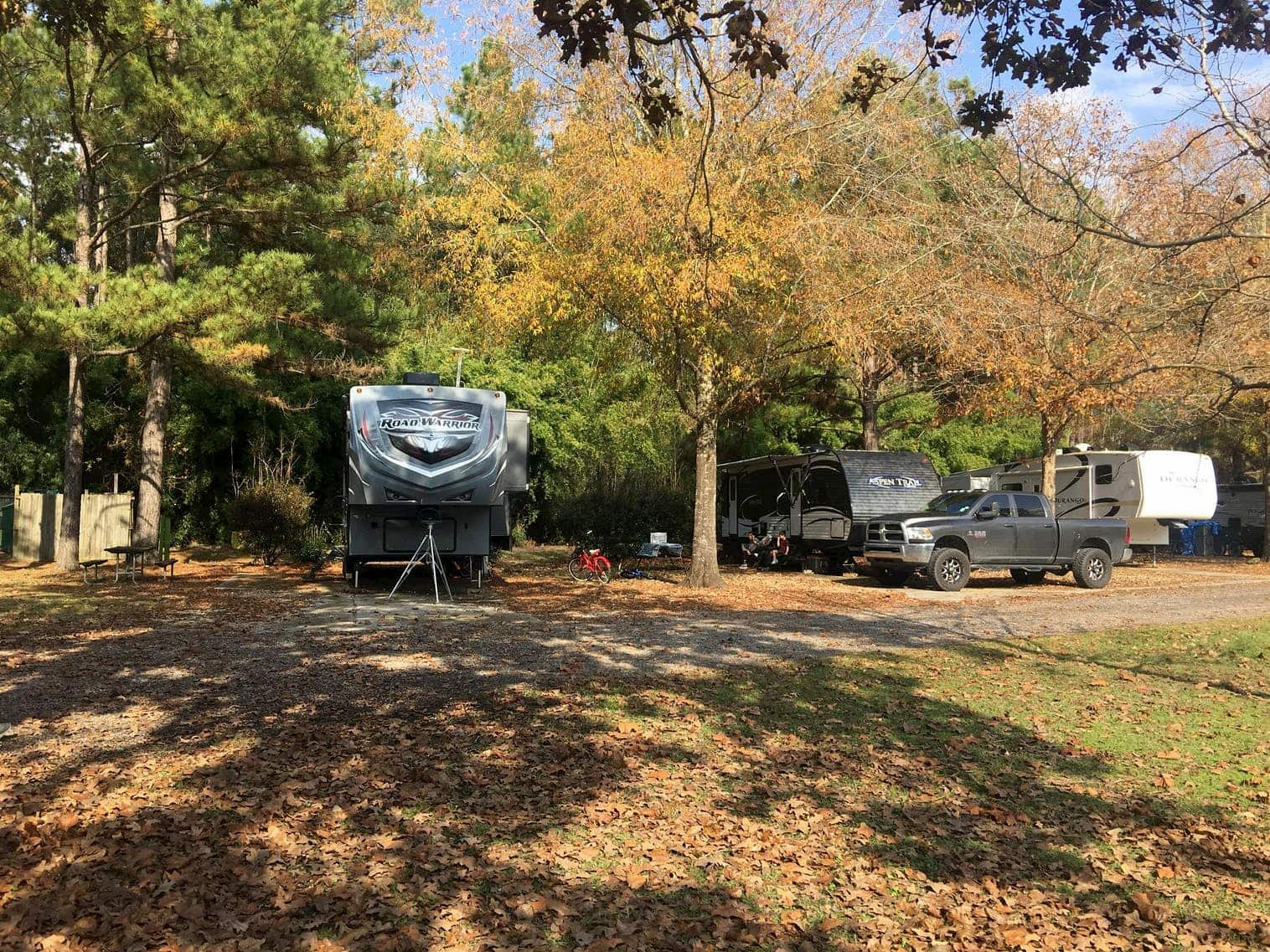 RV park in Louisiana in the fall under trees with changing foliage.