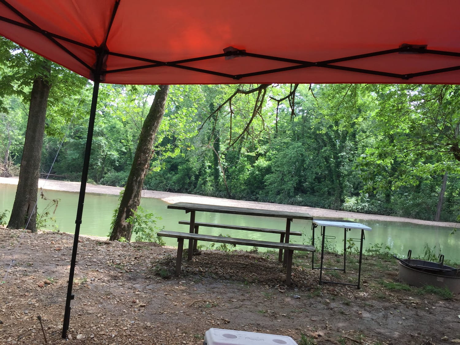 picnic bench riverside at campground