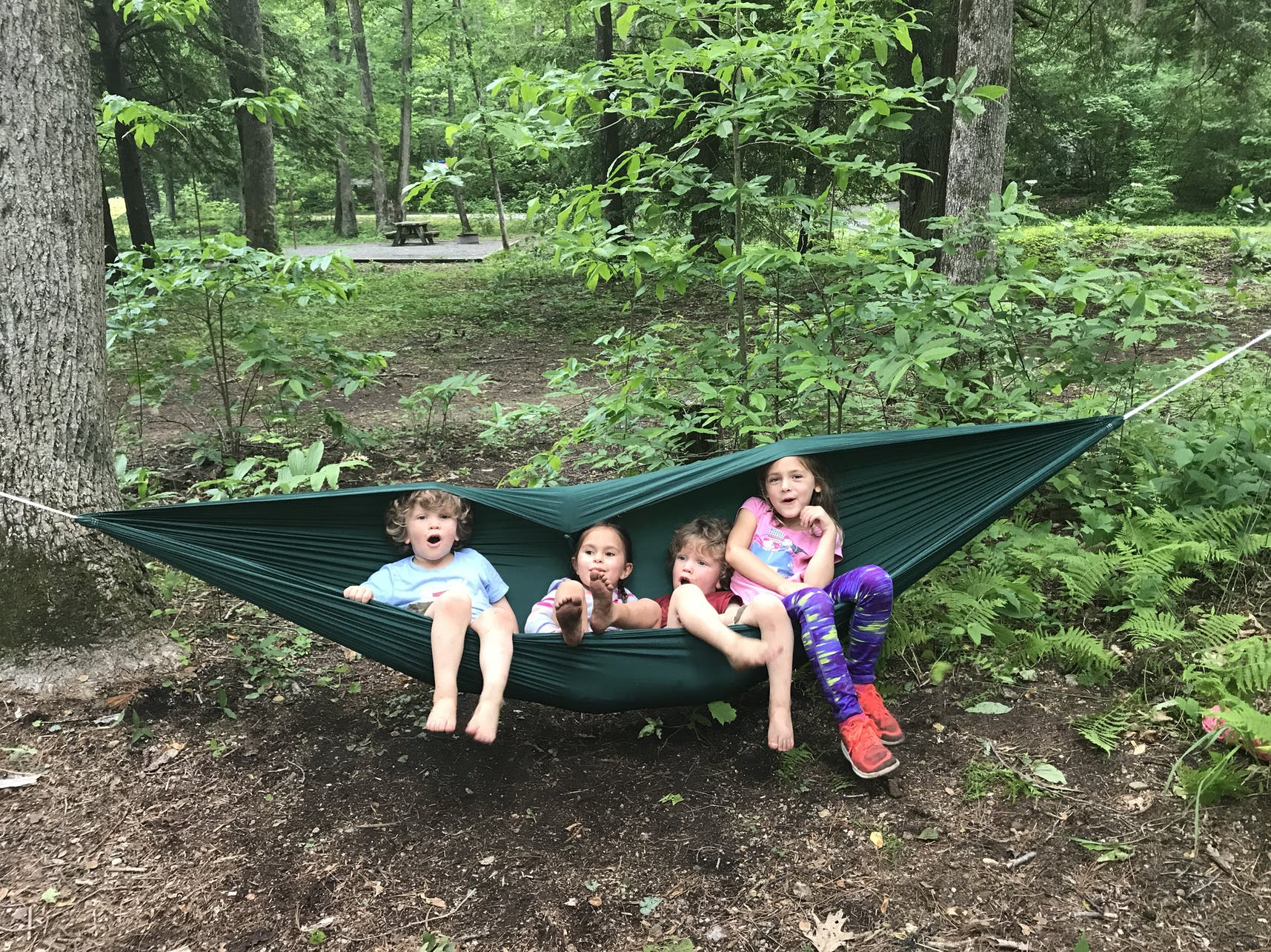 Kids hanging out in a hammock at a campsite in Northeastern Tennessee.