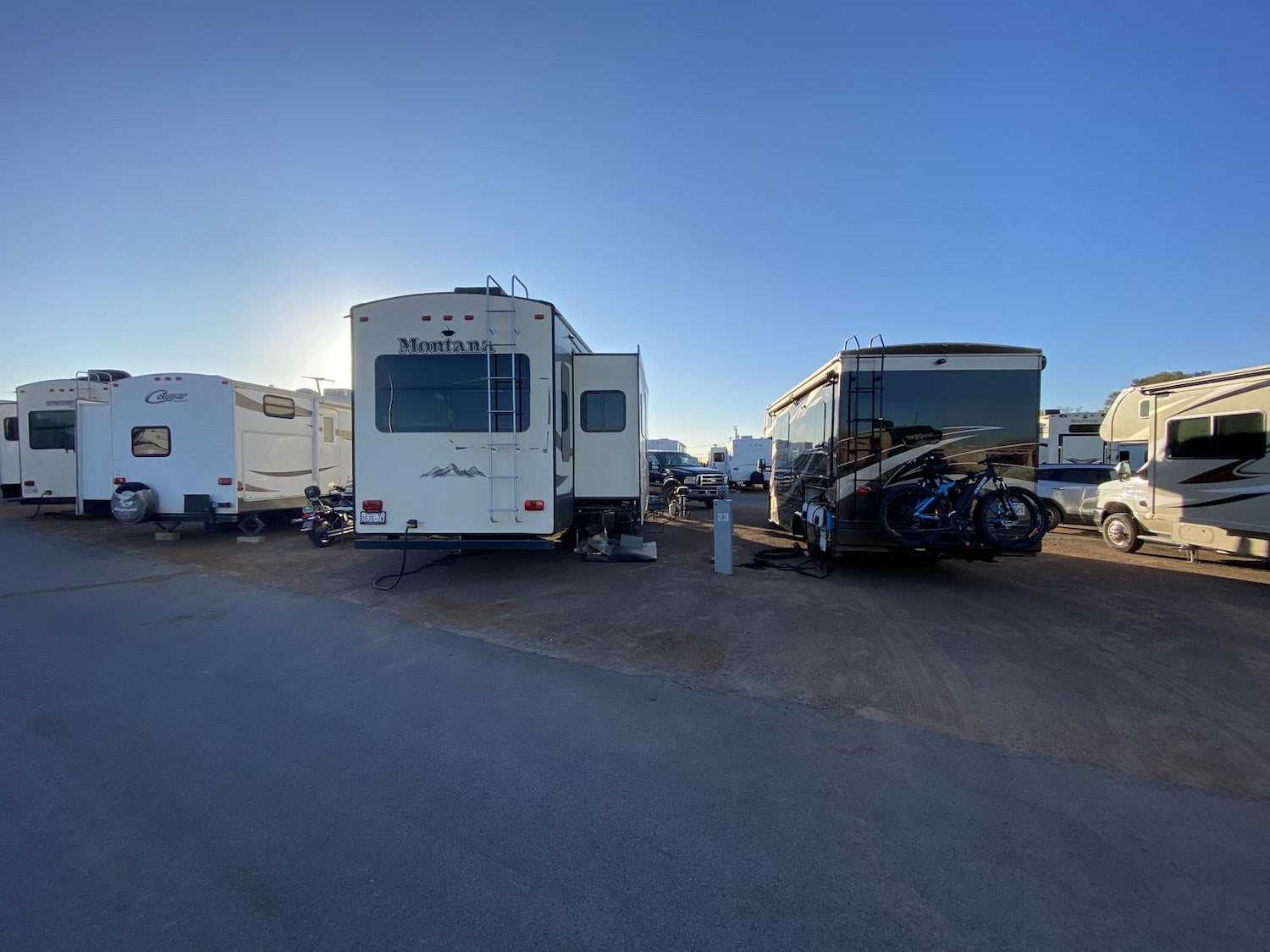 rvs parked in a row at rv park