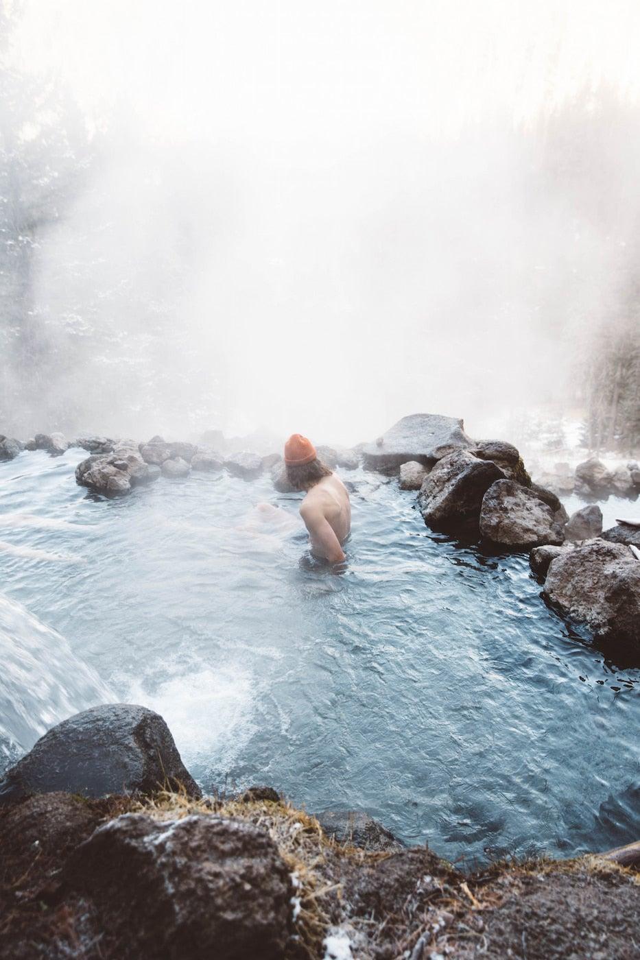 Man soaking in hot spring.