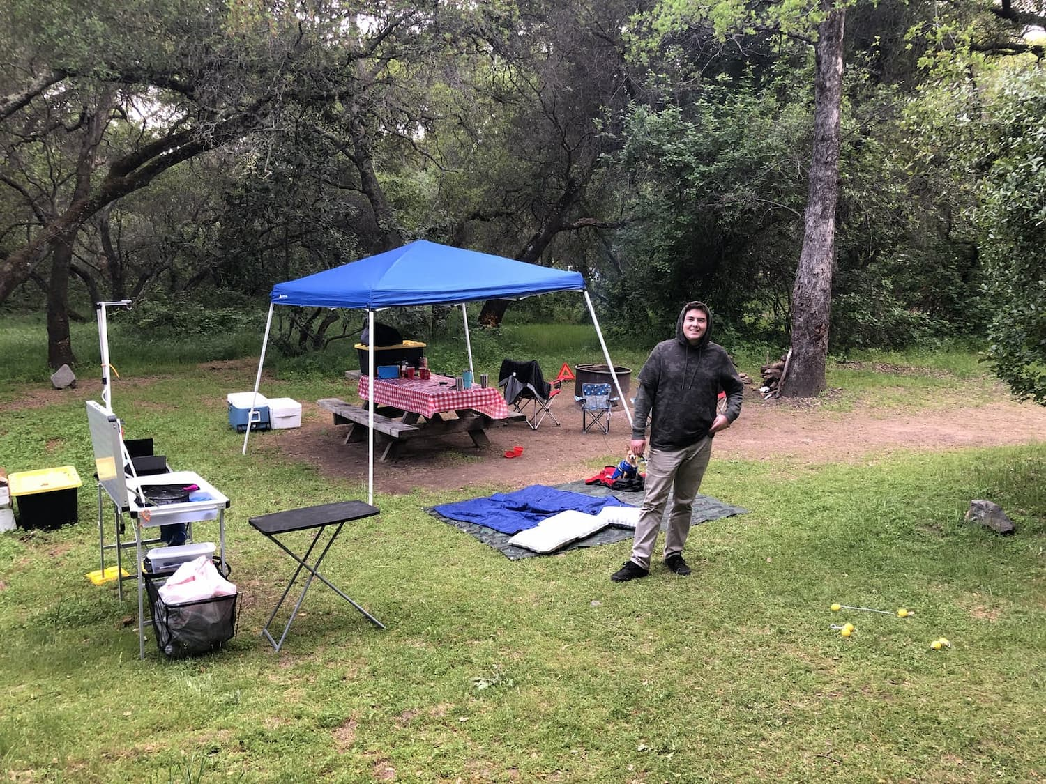 man standing in front of fully set up campground