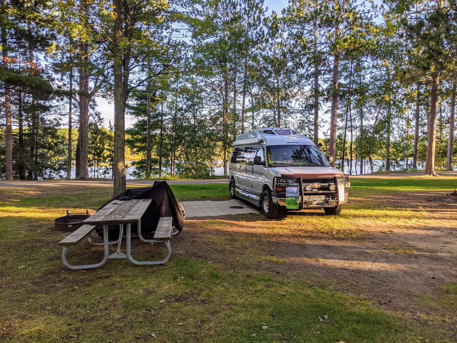 van and picnic table in forest
