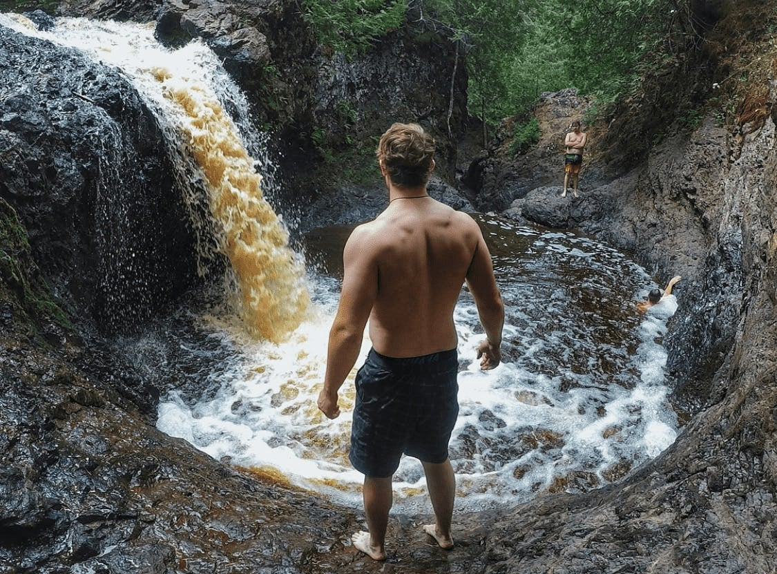 Guy jumping into the swimming hole at Wisconsin Amnicon Falls State Park.