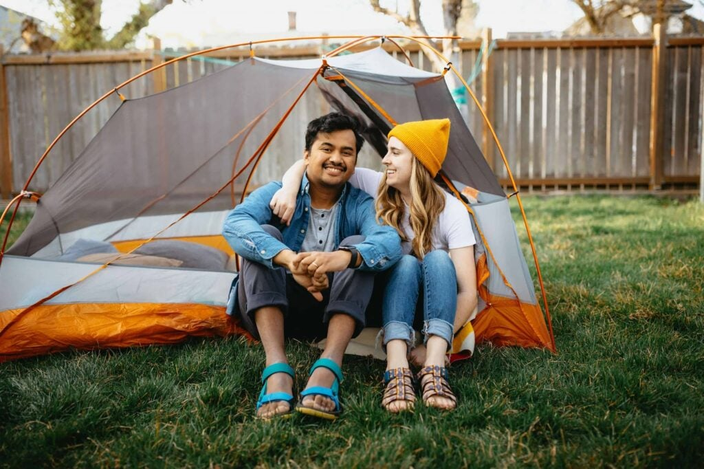 The Mandagies, Emily and Berty, in a tent in their backyard.