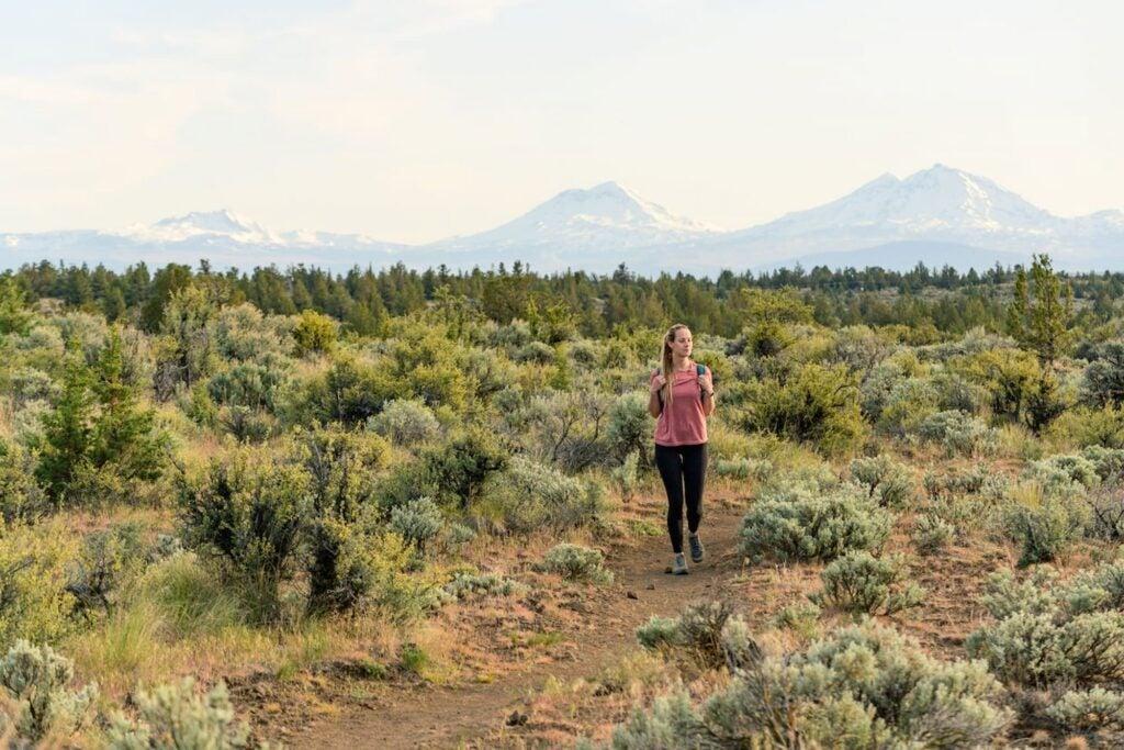 woman hiking in desert sagebrush