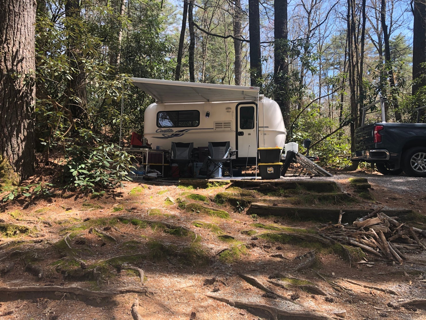 trailer parked in forested campspot