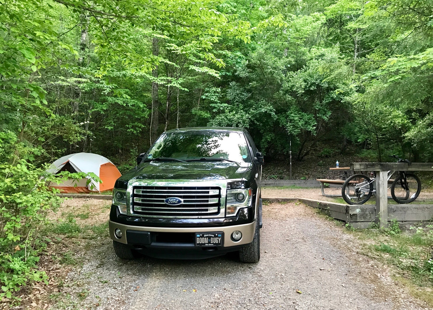 truck and tent set up at campsite