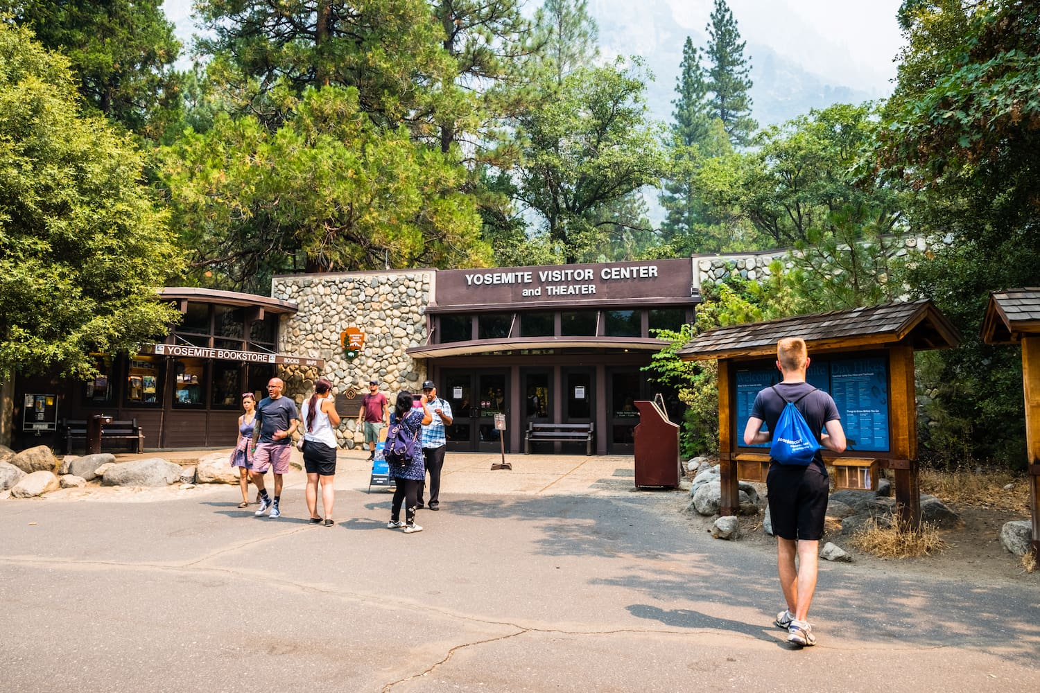 people walking in and out of yosemite visitor center