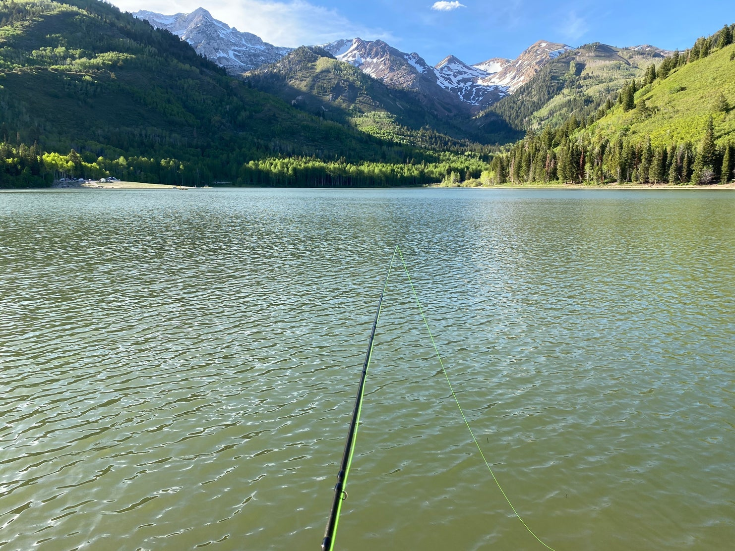 fishing pole on mountain lake