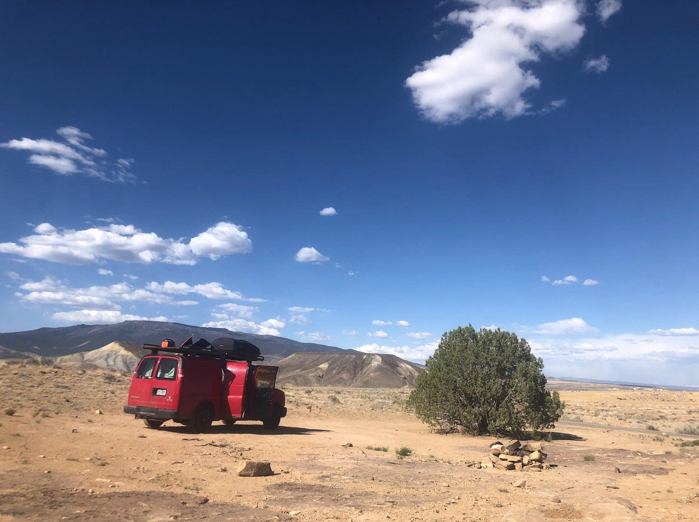 van in desert new juniper tree