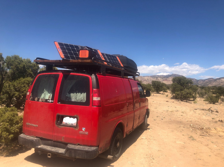 van with solar panels on top charging
