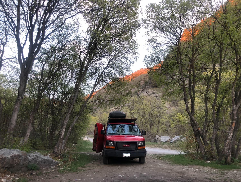 van sitting in forest