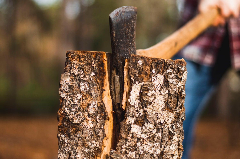 Camper chopping wood.