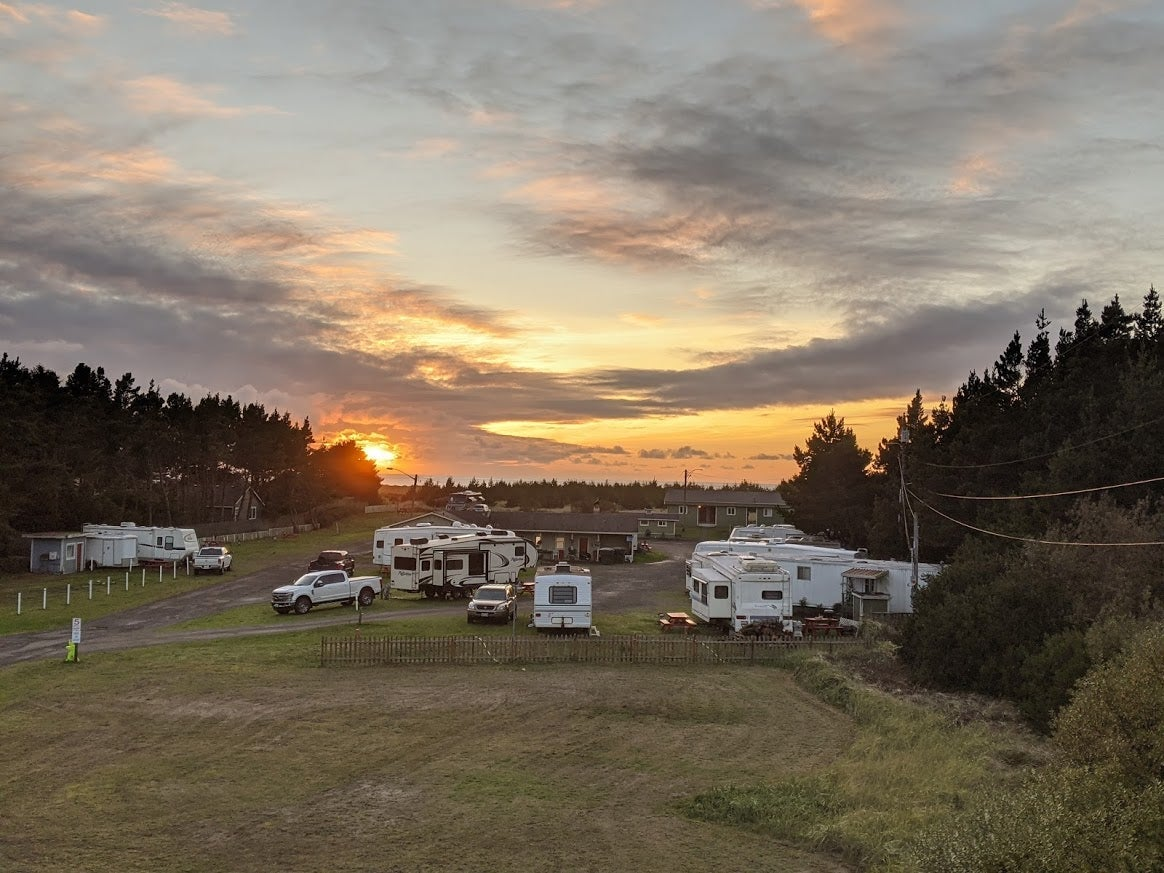 bunch of rvs parked at sunset