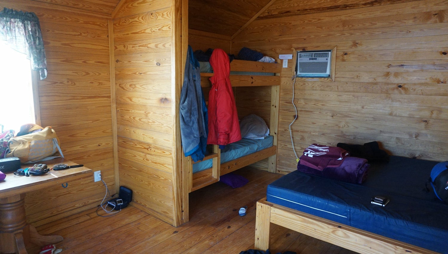 Interior of a camping cabin at the Horsetooth Reservoir with bunk beds.