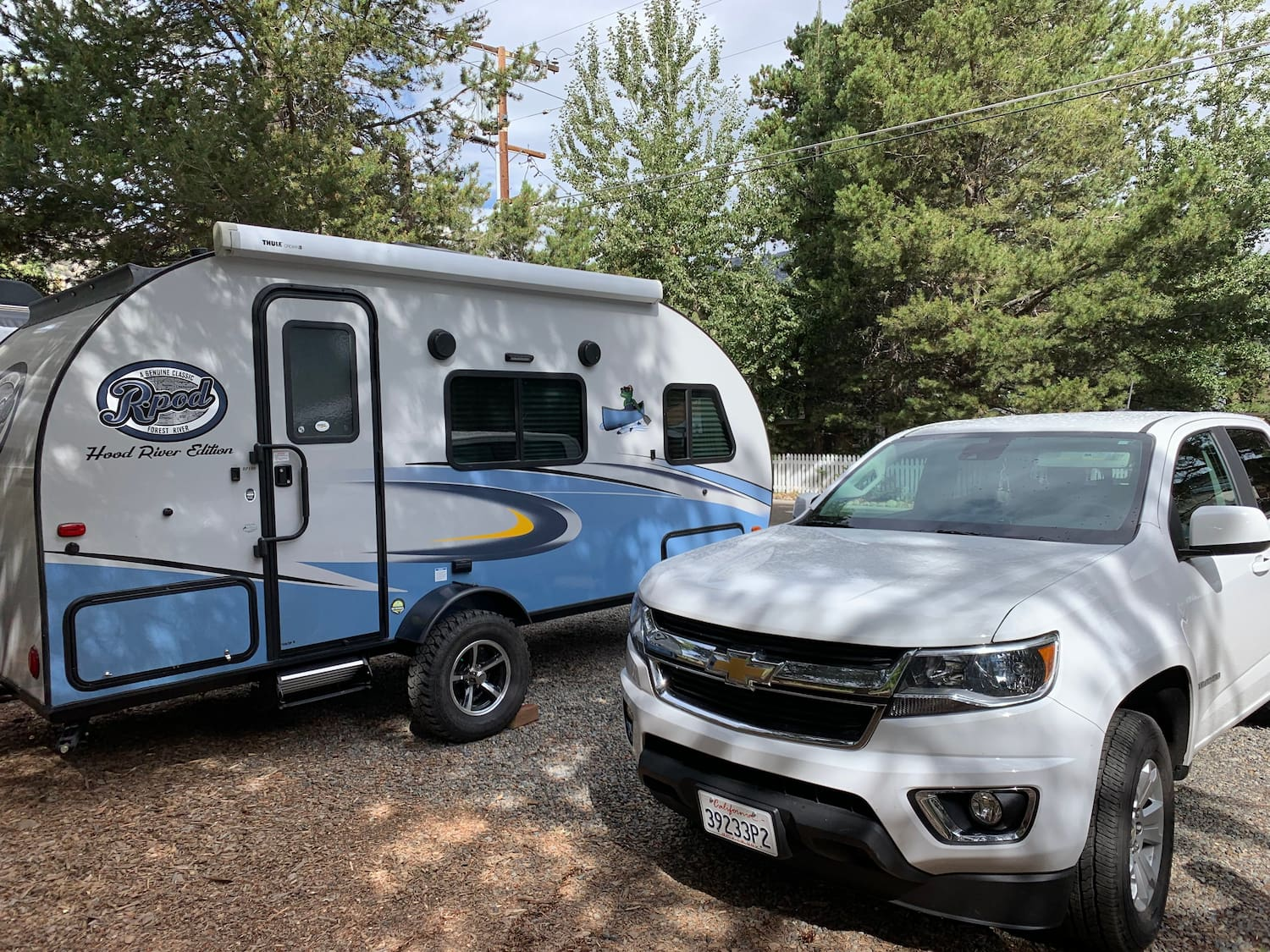 trailer and truck parked at campsite