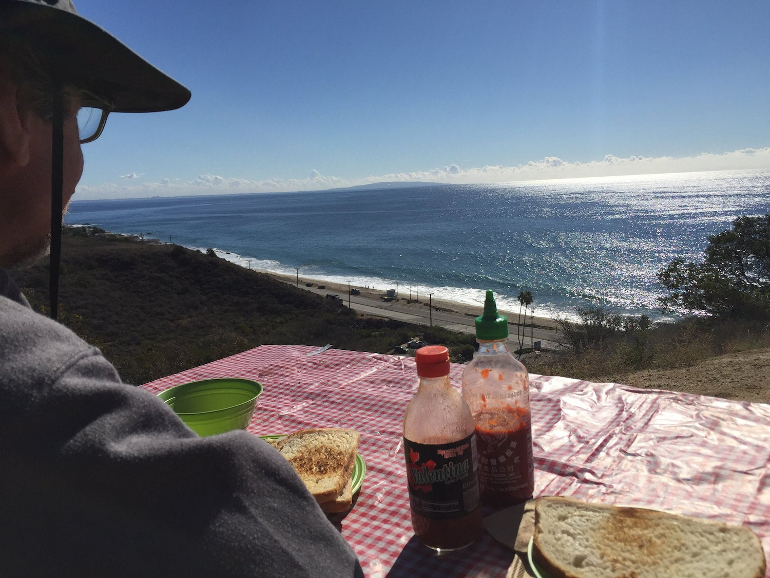 man at picnic table overlooking table