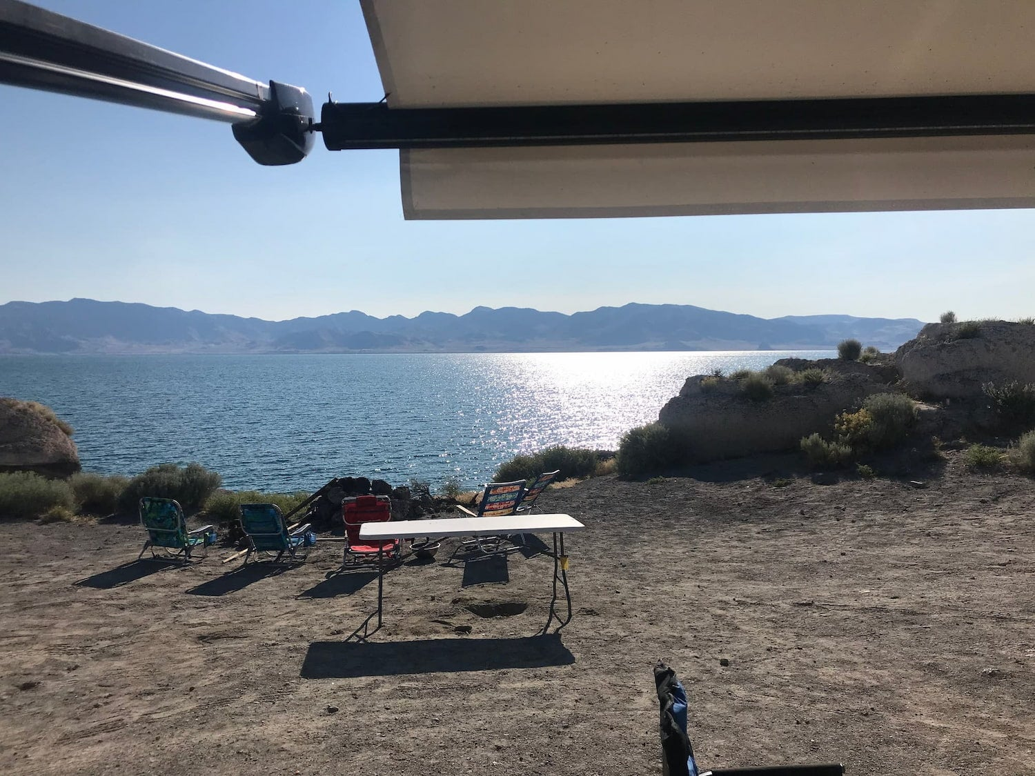 RV awning overlooking Pyramid Lake campsite.