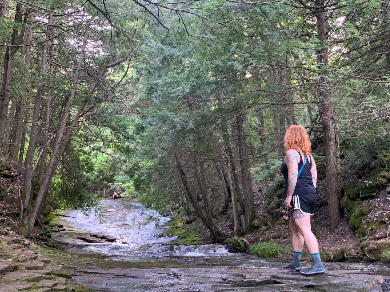 woman looking at creek