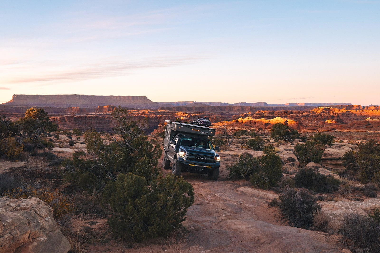 Bound for nowhere truck rig overlanding in a canyon in the southwest.
