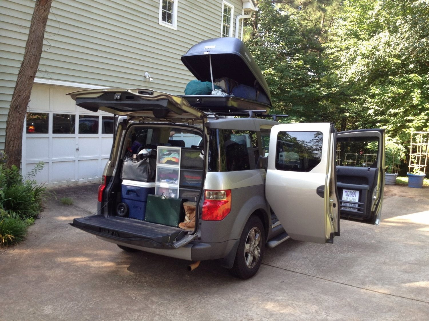 Honda Element packed to the brim with camping gear.