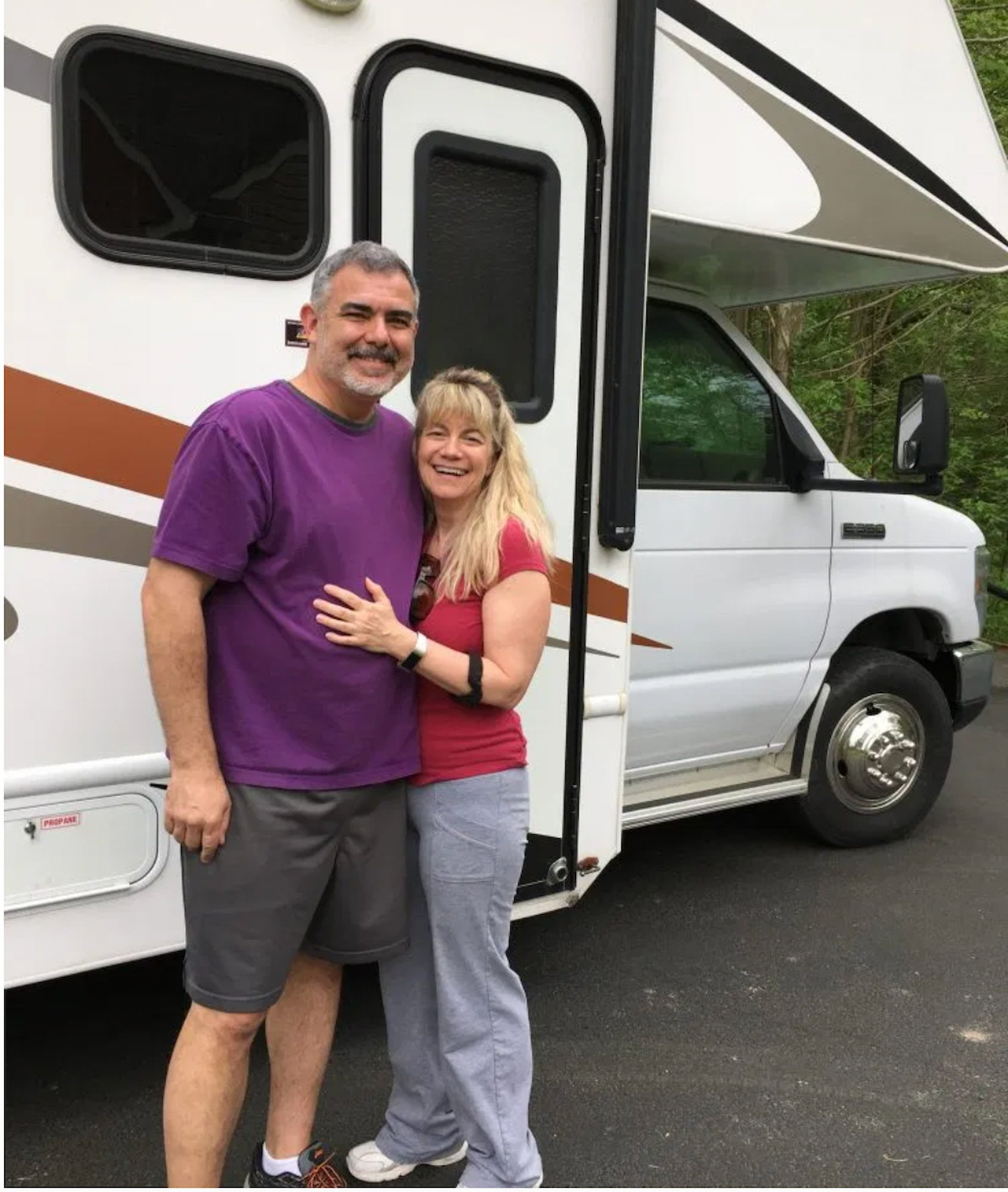 Mike and Susan with their Class C RV.
