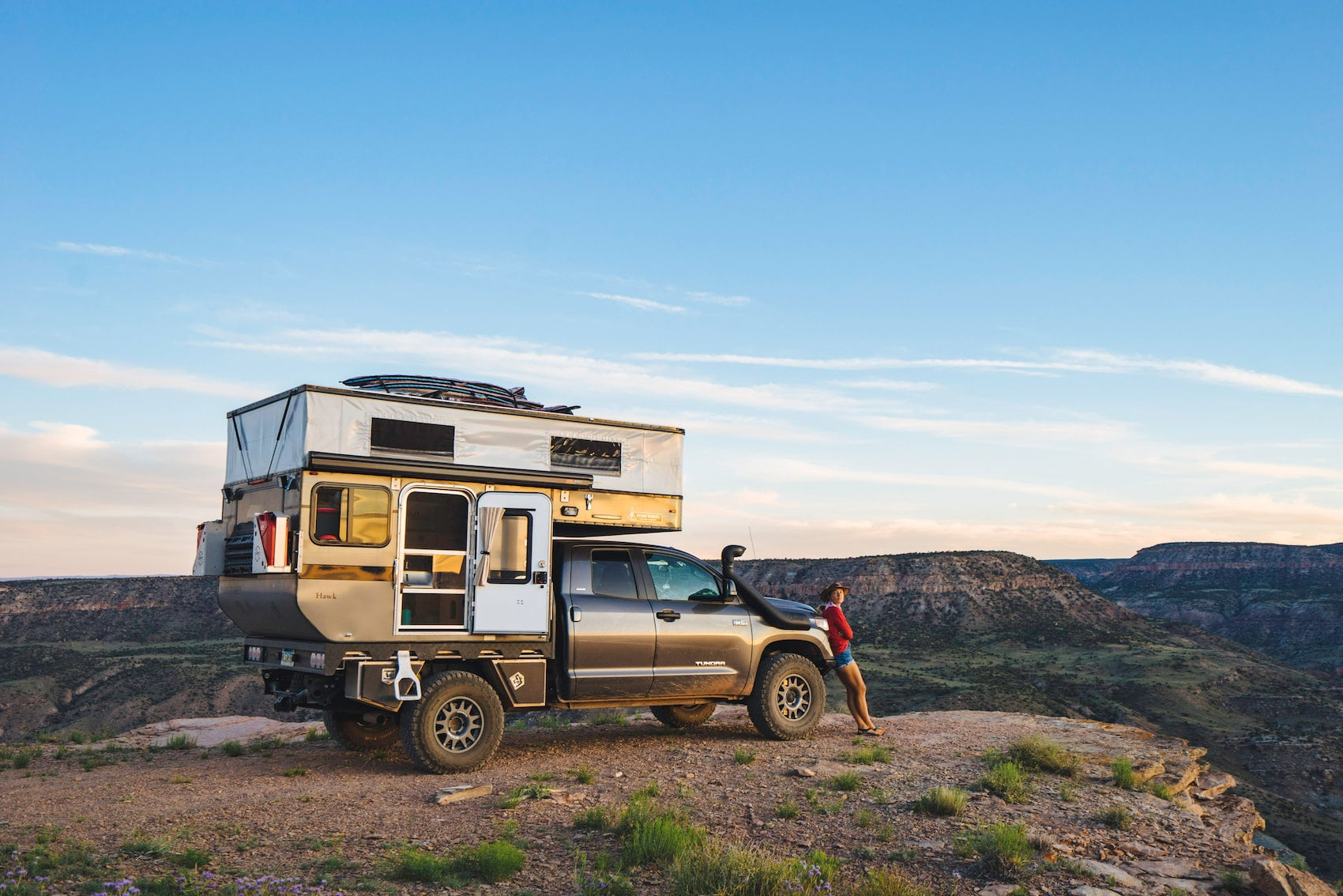 Bound for Nowhere's current rig a toyota tundra truck with pop up camper parked at the edge of a canyon.