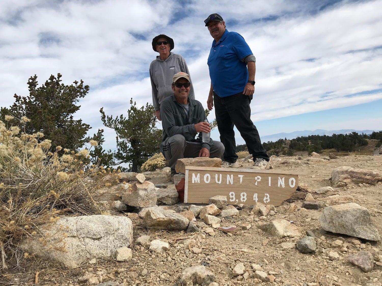 3 men on the peak of mount pinos