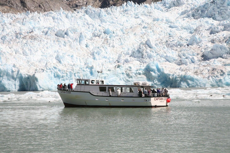 boat next to glacier