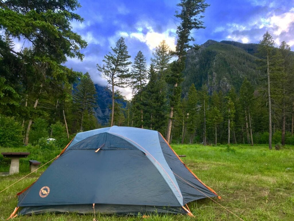 Tent in the foreground with Bozeman mountains in the background.