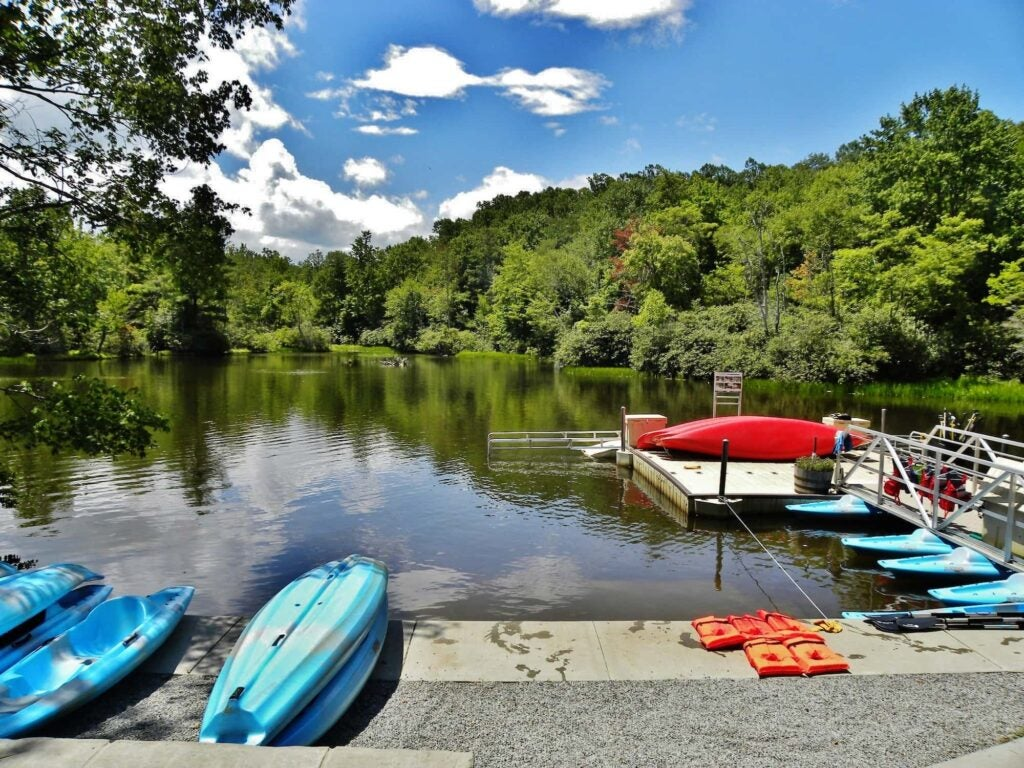 kayaks and paddleboards on the dock