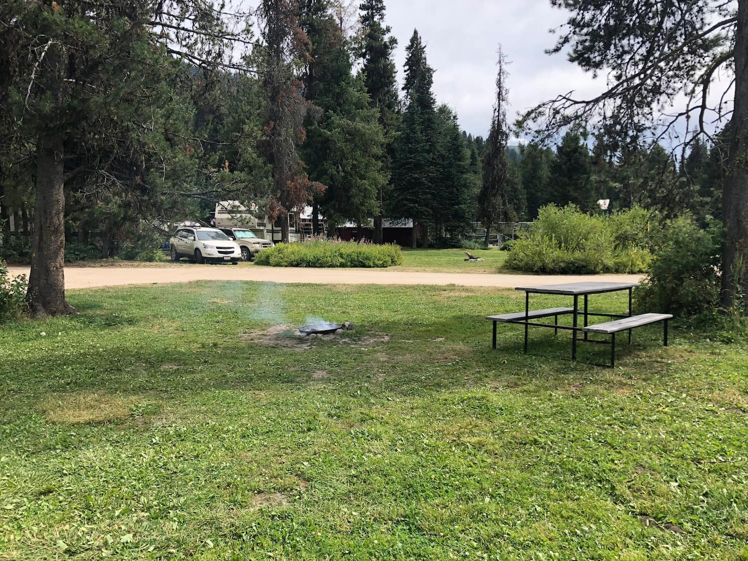 fire pit and picnic table at campground