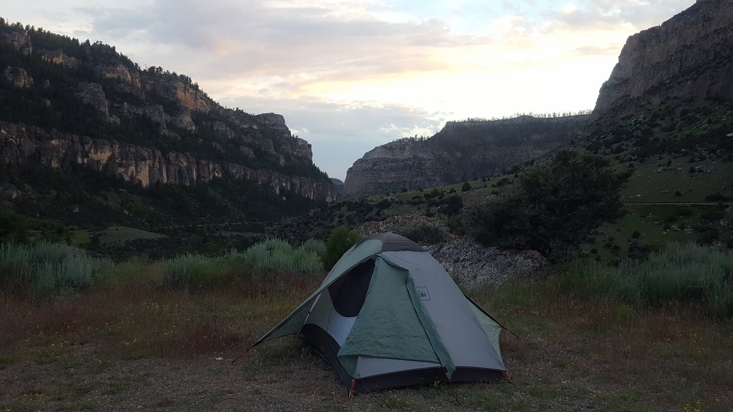 tent in rocks at sunset