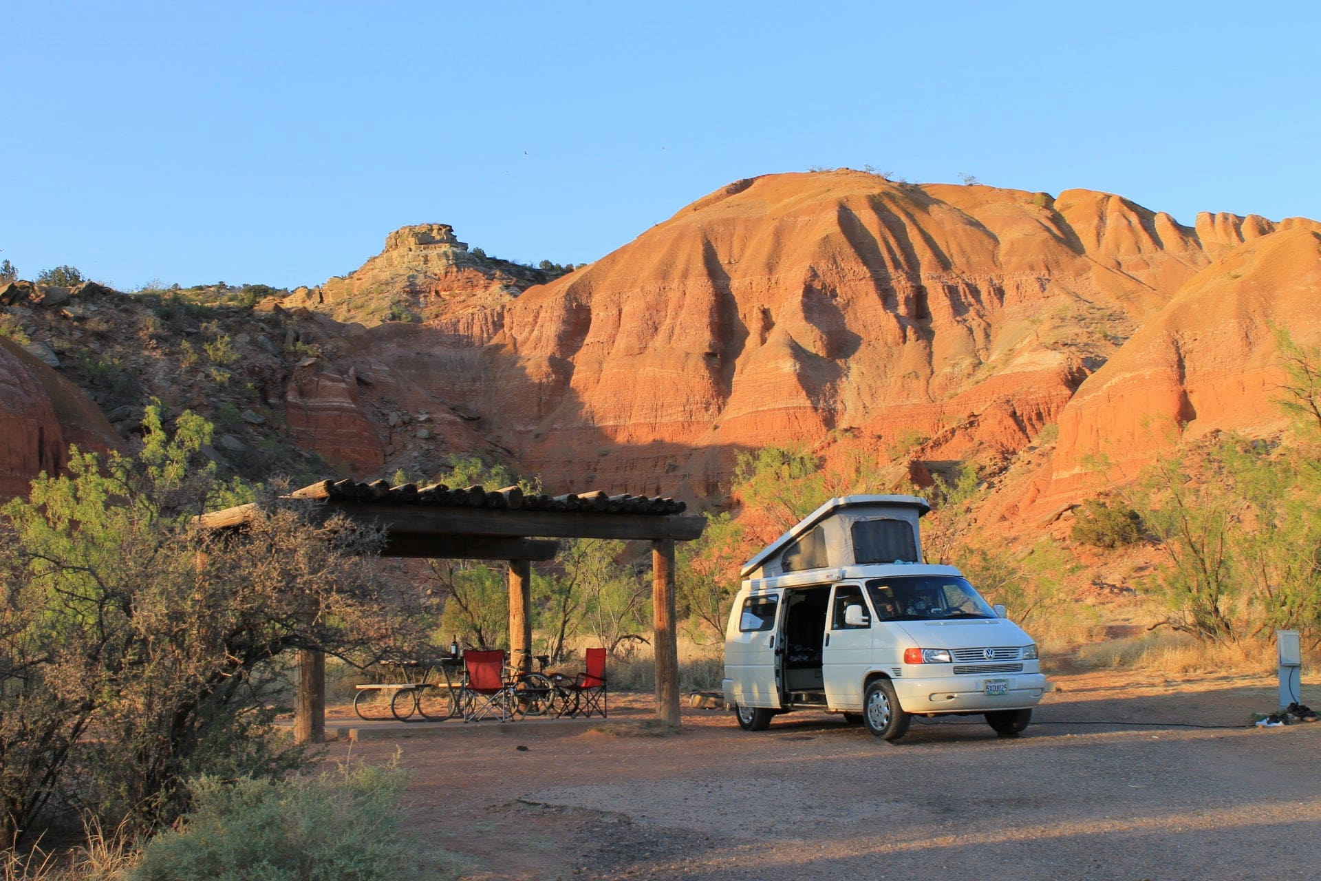 Van with pop up tent in the red rocks of Palo Duro Canyon.