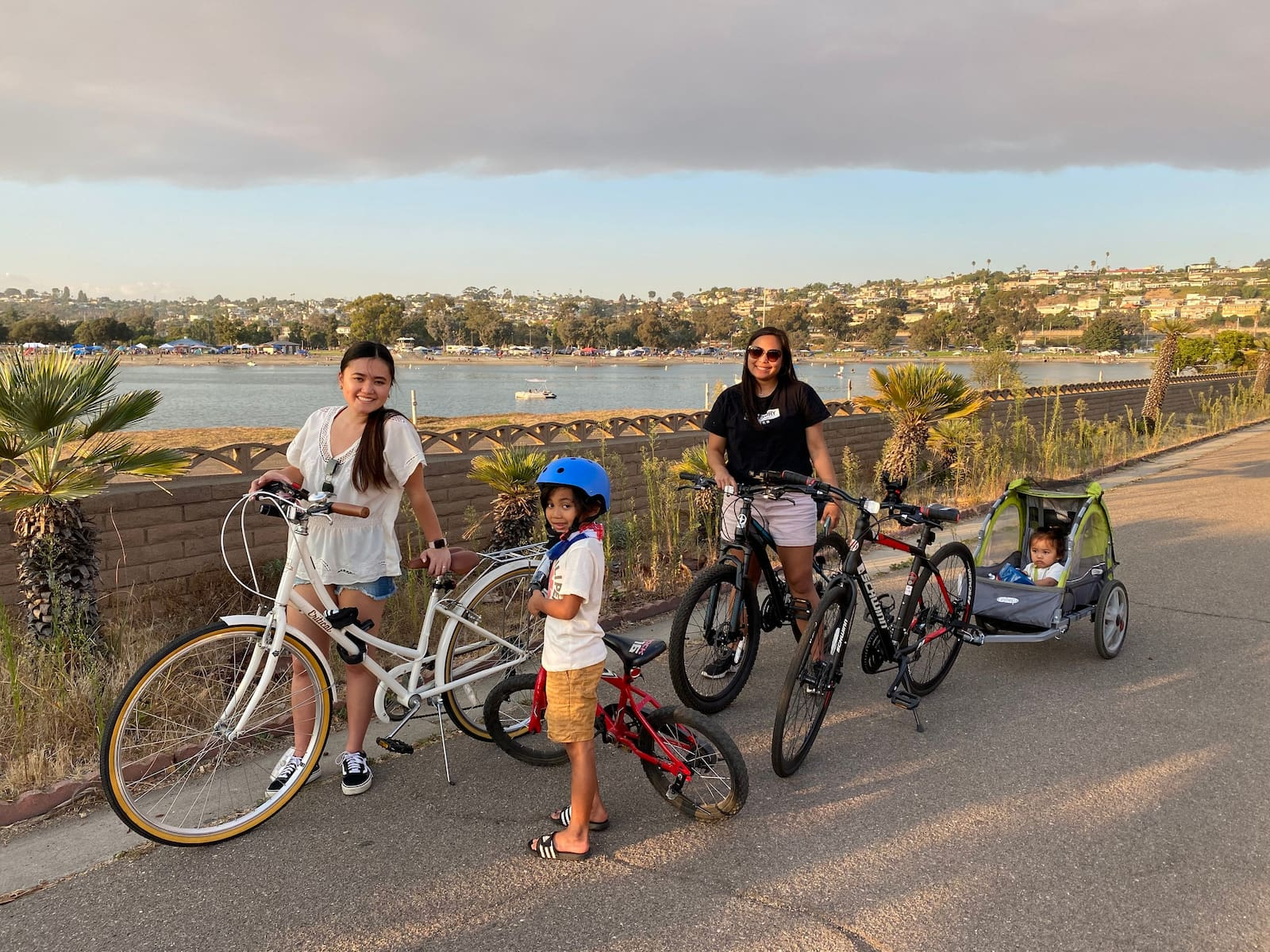 Family posing with their bikes along the coast of California.