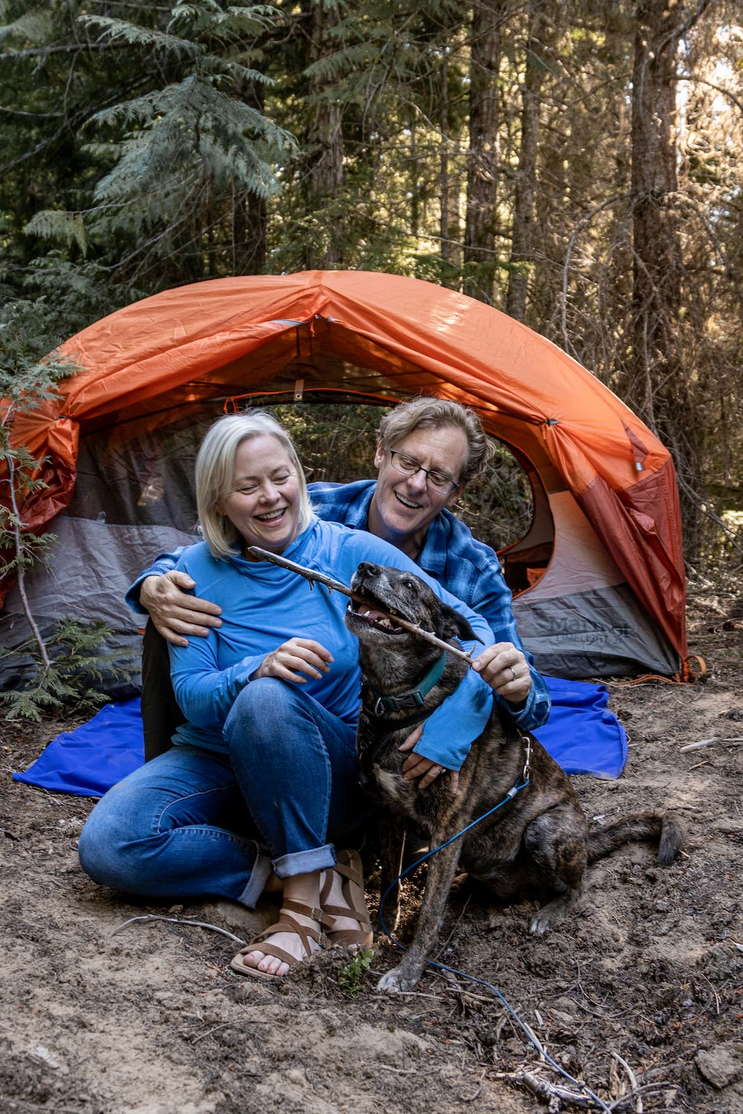 The Dyrt founders Kevin Long and Sarah Smith camping with their dog Brandy.