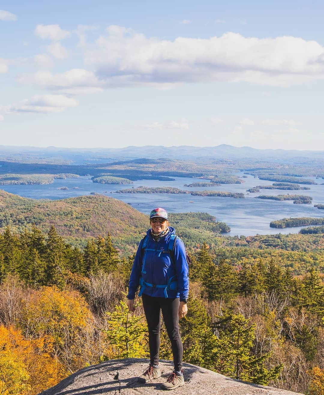 Kristin Bor founder of Bearfoot Theory blog hiking in the mountains of New Hampshire in the fall.