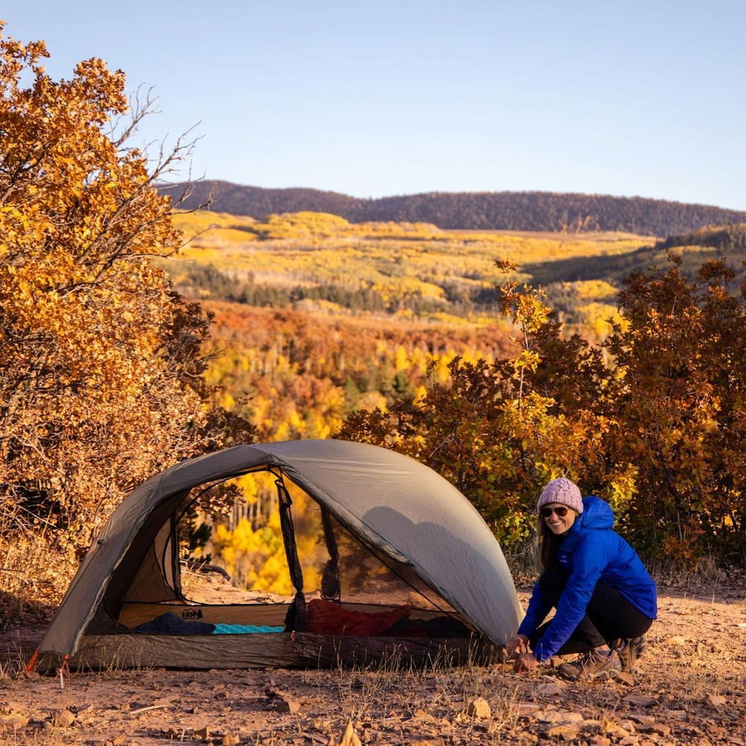 Kristin the founder of Bearfoot Theory setting up a tent in Colorado.