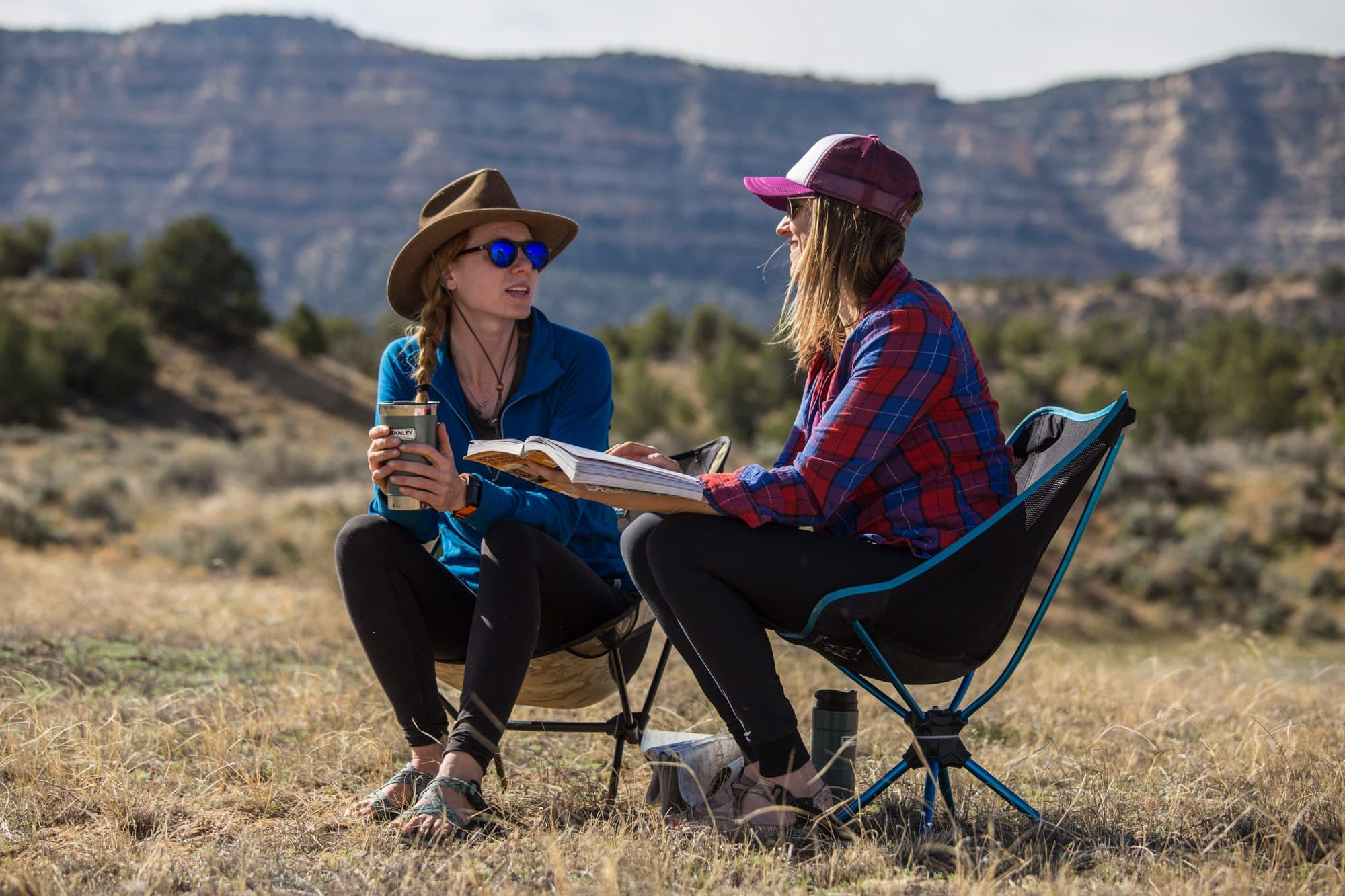 Women sitting in camping chairs.